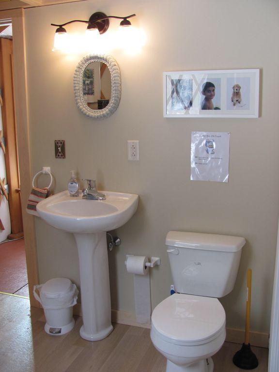The bath features a sink, toilet and shower.