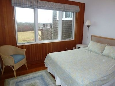 2nd bedroom includes water view and queen bed.