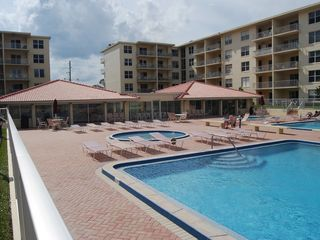 New Smyrna Beach condo photo - Two large pools plus kiddie pool and poolside cabanas