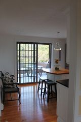 Sagamore Beach house photo - Patio slider off the kitchen leads to an upper and lower sun deck.