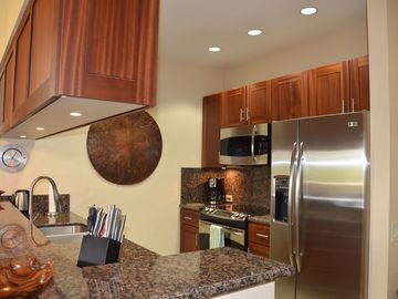 Newly renovated Kitchen with African mahogany cabinetry and granite counters.