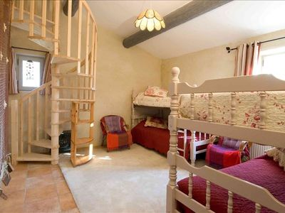 One king-size bed on the main level and room for 3-4 kids in the loft area.