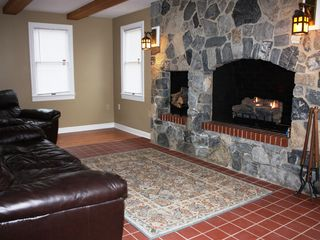 Harpers Ferry house photo - Massive stone fireplace and gas fire logs with leather sofa in great room