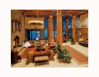 McCoy Peak Lobby with wood burning fireplace, front desk and access to the slope