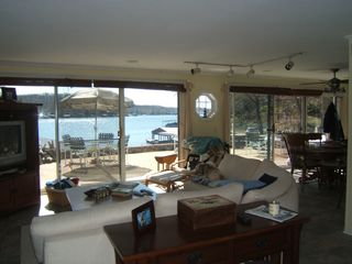Gravois Mills house photo - Living with full views of water. Easy access to outdoor living as well.