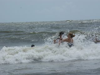 Tybee Island condo photo - Playing inthe surf at high tide, a good time for body surfing.