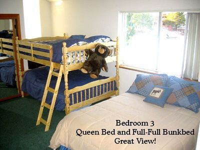 3rd bedroom with bunkbeds and queen bed