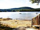 Beautiful Sandy Beach, Ideal for Swimming and Wading - Brant Lake farmhouse vacation rental photo