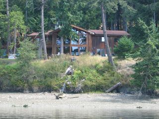 Pender Island house photo - A picture of the house taken from the dock