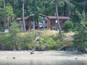 A picture of the house taken from the dock