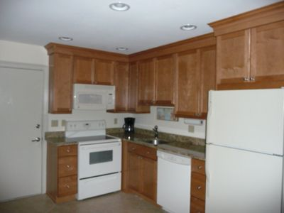 Kitchen is Updated with Granite, Overhead Lighting and 42' Cabinets