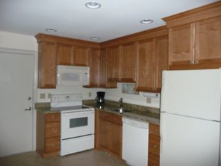 Folly Field villa photo - Kitchen is Updated with Granite, Overhead Lighting and 42' Cabinets