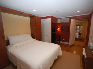 Downtown - Washington DC apartment photo - Queen sized bed Murphy bed folds from down from built in cabinets