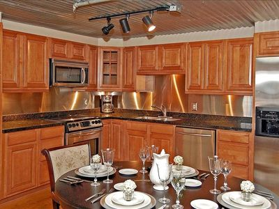 Fully Equipped Kitchen with Stainless Appliances and Granite Countertops