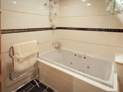 Enjoy the jetted tub after a long day of sightseeing.