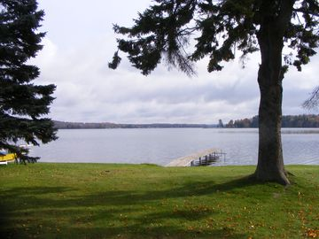 Great view of large yard with private dock and lake frontage.