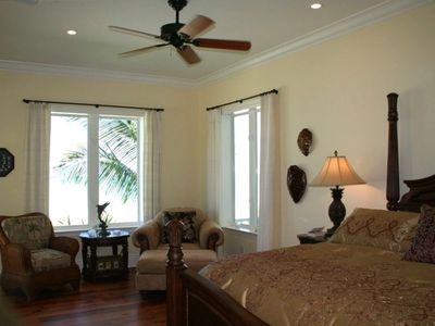 Beautiful master bedroom overlooking the beach.You are surronded by water!