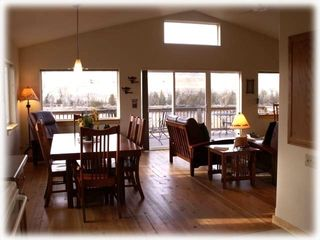 Livingston house photo - The dining and living areas are bright and sunny with views of the river