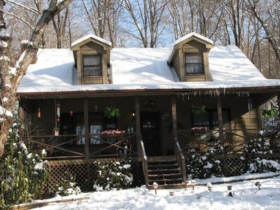 THE FRONT OF THE CABIN IN THE WINTER WITH SNOW.,,,,BEAUTIFUL!