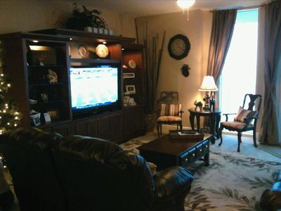 "Plush leather furniture, beautifully decorated which includes a 55"" LCD TV"