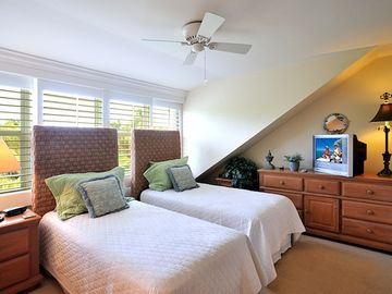 The second bedroom has twin beds that convert to a king bed.