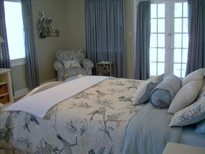 Large cottage cozy room with queen size bed, t.v. & french doors out to deck