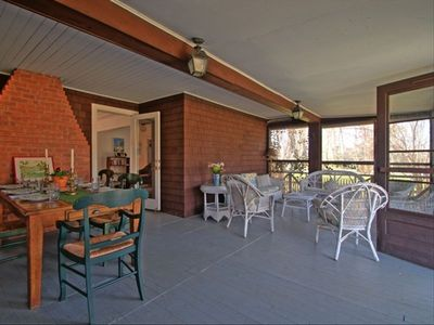Screened porch with dining area and glider