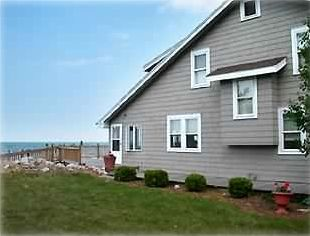 Port Clinton house rental - side view of home with view of Lake Erie and peek of large front deck