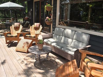 Main level - deck seating with 4 adirondack rockers and cushioned glider