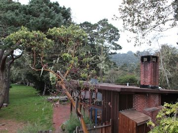 View of house and meadow above Tomales Bay.