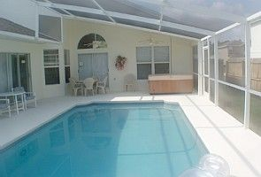 Solar heated,screened pool with SPA and patio area