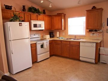 The kitchen area includes all appliances.