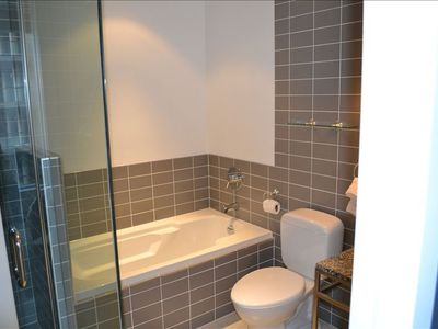 Toronto condo rental - Main Washroom. Shower and soaker tub.