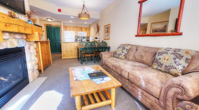 TX212 Taylors Crossing - a SkyRun Copper Property - Living Room - The sofa in the living roo pulls out to a queen size bed to sleep 2 additional people.
