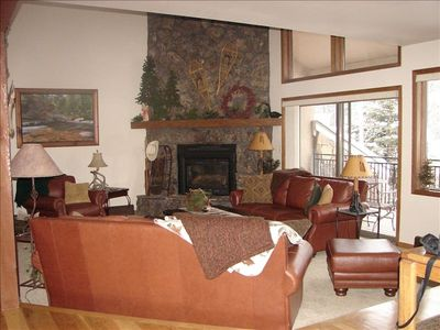 Warm leather furniture, River Rock fireplace, scenic views of Keystone