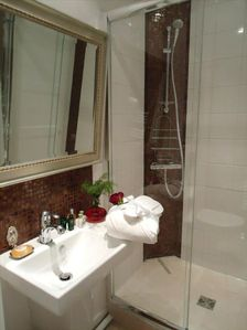The bathroom with Italian shower & mosaic (robes, towels VIP welcome guest)