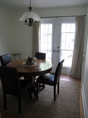 Lunenburg house photo - Dining room with entrance onto backyard deck and BBQ