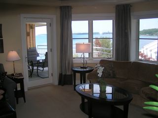 Traverse City condo photo - Pool with hot tub and beach beyond