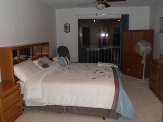 Gravois Mills house photo - Upstairs bedroom with king bed, TV with DVD player, balcony overlooking the lake