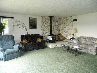 Stratton house photo - Large spacious living room with gorgeous views. Wood burning wood stove.