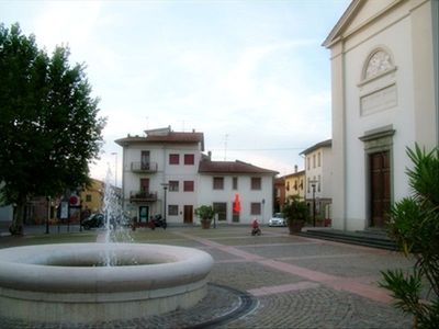 Live like the locals! - View of the town square and entrance