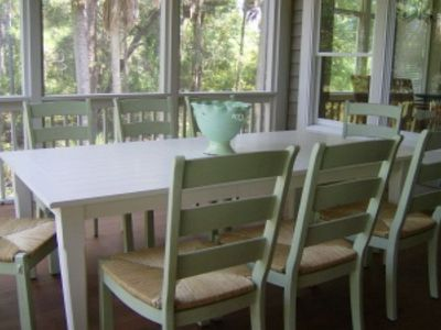 Large dining table on screened porch