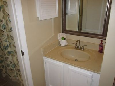 Sink and vanity area by bedroom.