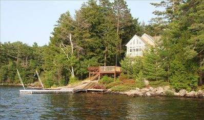 View of cottage and docks from the lake