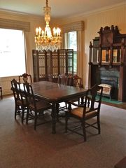 Oxford house photo - Formal dining room with fireplace and wonderful chandelier and china cabinet.