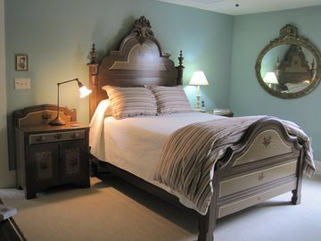 Guest room furnished w/ a Victorian 'painted cottage set', has a full size bed.