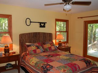 Lake Gaston house photo - bright master bedroom, queen bed - door opens onto back deck