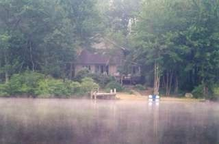 Big Bass Lake house rental - Early morning view of the house from our canoe