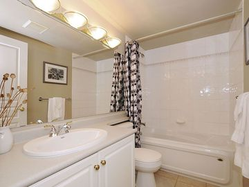 Ensuite bathroom with tub and shower