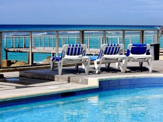 St. Lawrence Gap condo photo - Relax at our beachfront private pool as you listen to the soft waves